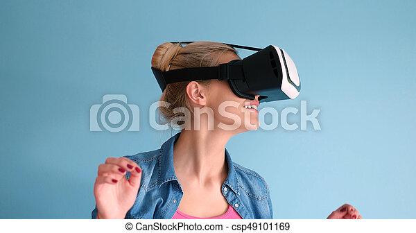 e3895008e1a3 Woman using vr headset glasses of virtual reality. Happy girl ...