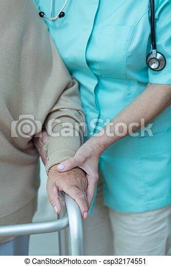 Woman using walking frame - csp32174551