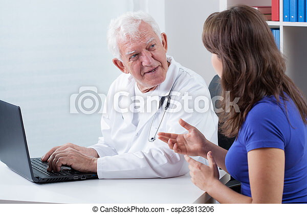 Woman visiting experienced physician - csp23813206