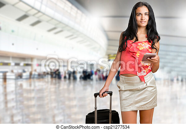 Woman waiting in an airport - csp21277534