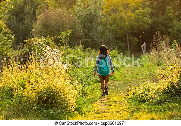 Woman walking in wild nature - csp86616971