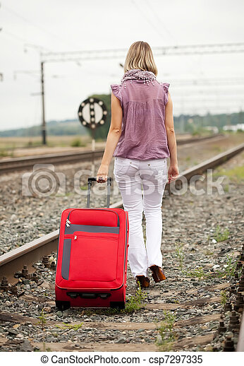 woman   walking on rail road - csp7297335