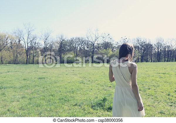 woman walking through a meadow - csp38000356