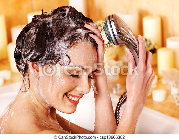 Woman washes her head at bathroom. - csp13666302