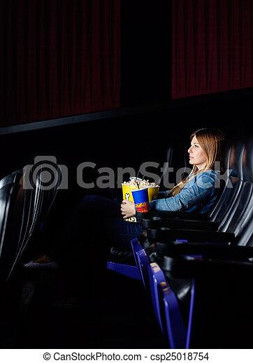 Woman Watching Movie At Cinema Theater - csp25018754