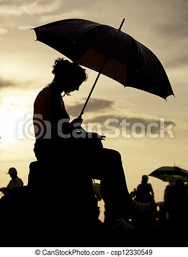 woman watching the sunset - csp12330549