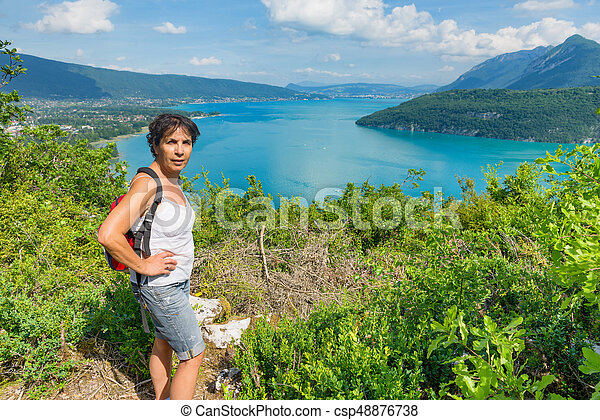 woman watching view of Lake Annecy - csp48876738
