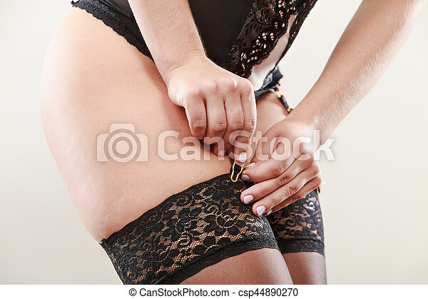 Woman wear garter belt and stockings. - csp44890270