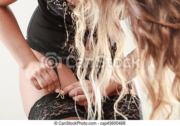 Woman wear garter belt and stockings. - csp43600468