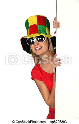 Woman wearing a comical hat and sunglasses - csp8795893