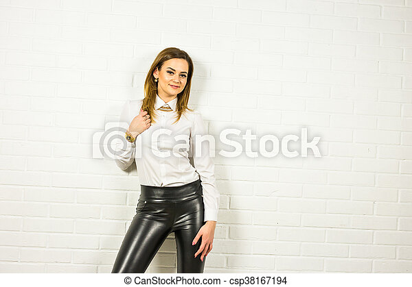 669035a1b99 Woman wearing black leather pants and high heel shoes