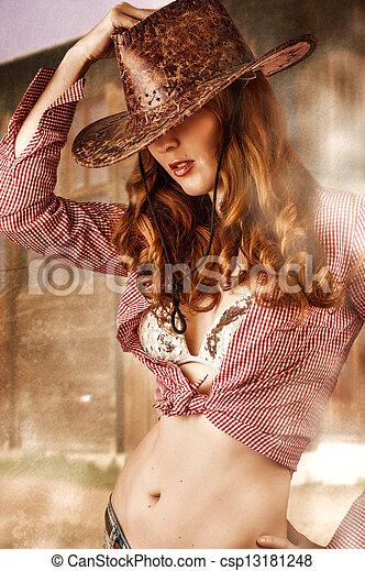 Woman wearing cowboy hat - csp13181248 8dd094626747