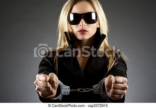 woman wearing handcuffs - csp3372915