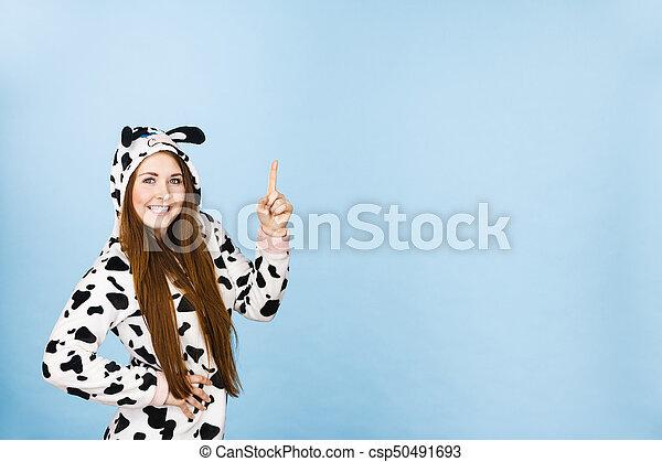 Woman wearing pajamas cartoon pointing up - csp50491693