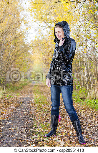 Woman Wearing Rubber Boots In Autumnal Nature Canstock