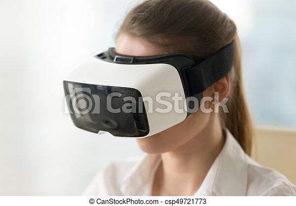 a66b05599e97 Woman wearing virtual reality glasses, vr headset, portrait head ...