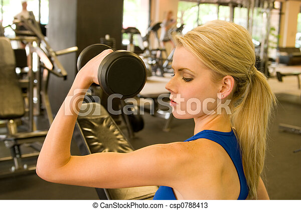 woman weightlifter beautiful blond woman lifting weights