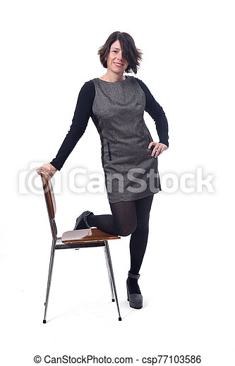 woman with a chair in white background - csp77103586