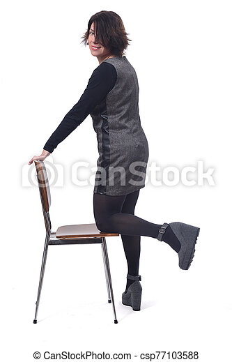 woman with a chair in white background - csp77103588