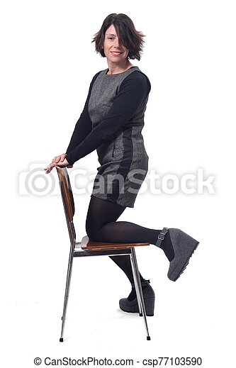woman with a chair in white background - csp77103590
