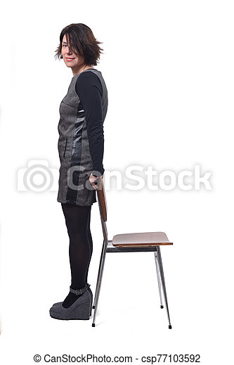 woman with a chair in white background - csp77103592