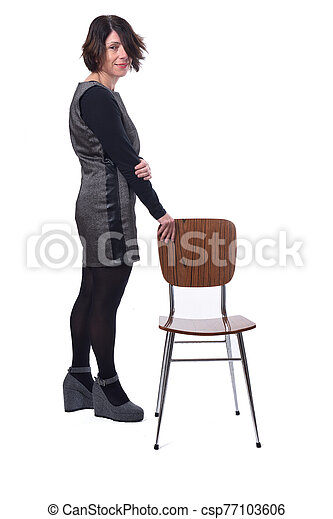 woman with a chair in white background - csp77103606