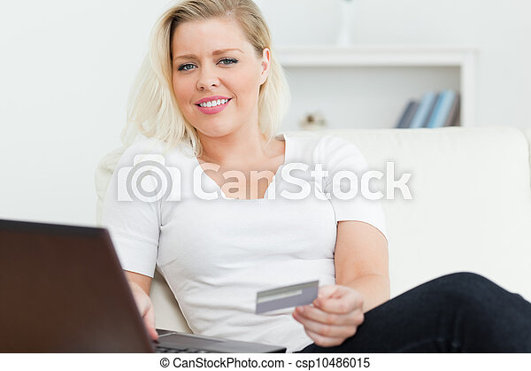 Woman with a credit card in her hand - csp10486015