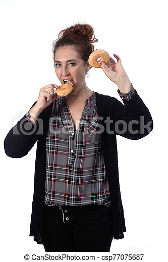 woman with a donut on white background - csp77075687