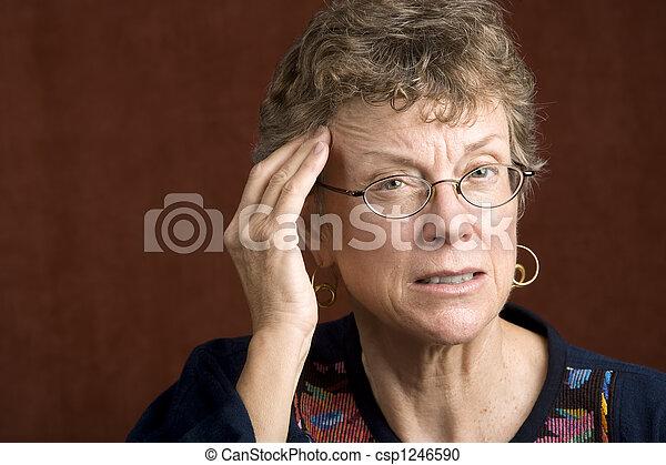 Woman with a headache - csp1246590