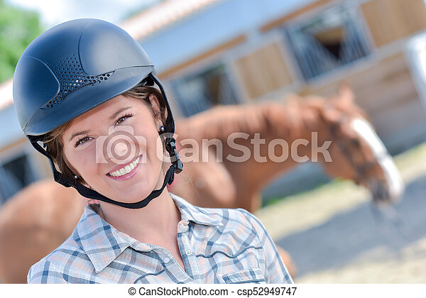 woman with a horse in the background - csp52949747