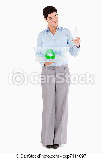 Woman with a plastic bottle and a recycling box - csp7114097