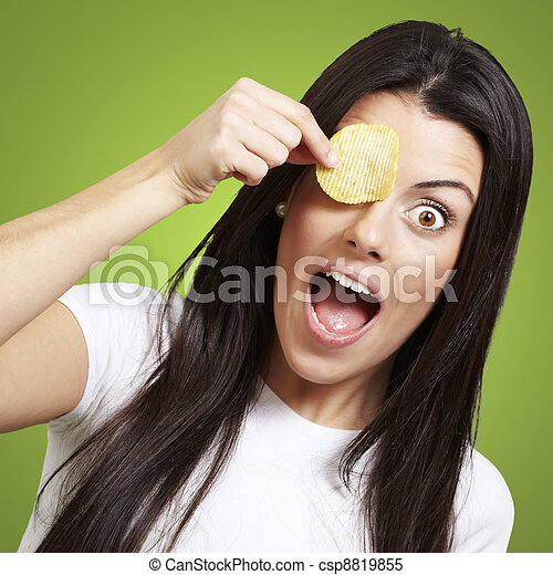 woman with a potatoe chip - csp8819855