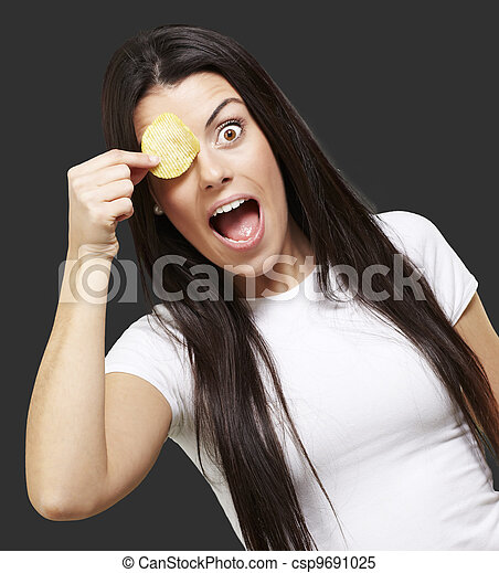 woman with a potatoe chip - csp9691025