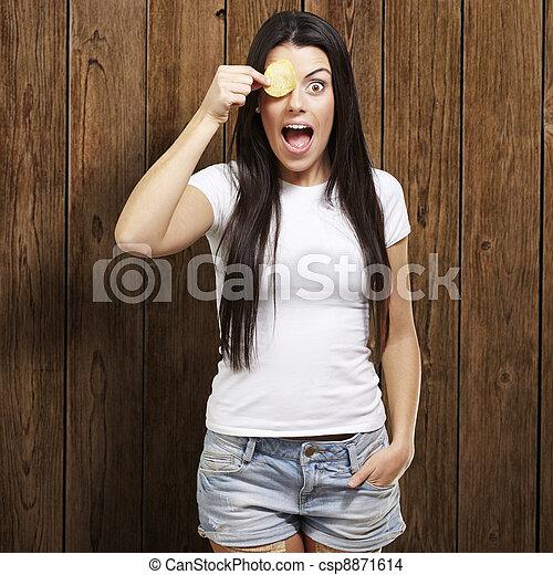 woman with a potatoe chip - csp8871614