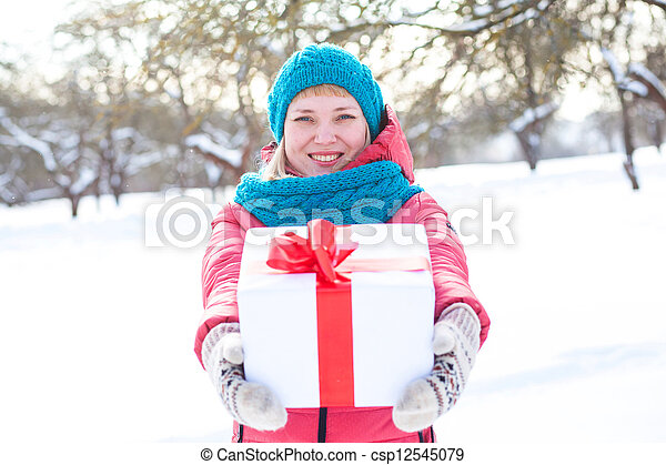 Woman with a present - csp12545079