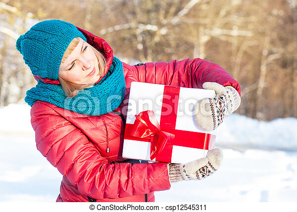 Woman with a present - csp12545311
