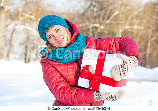Woman with a present - csp12545314
