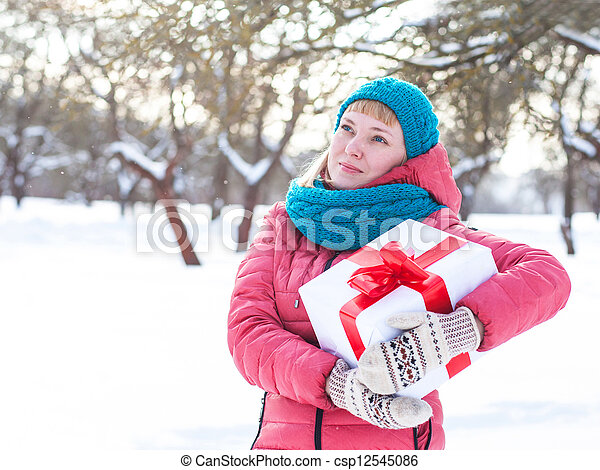 Woman with a present - csp12545086