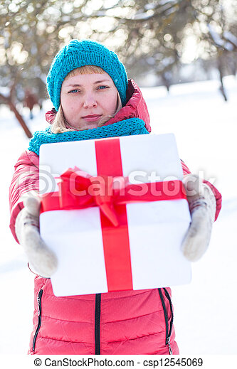 Woman with a present - csp12545069