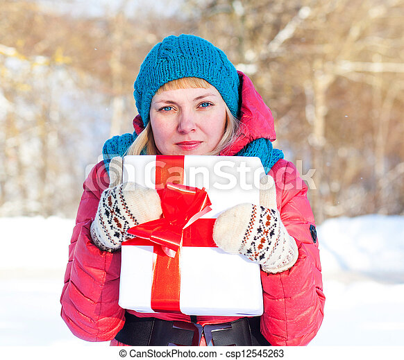Woman with a present - csp12545263