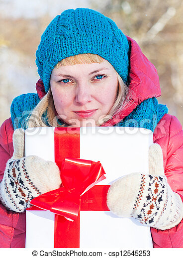 Woman with a present - csp12545253