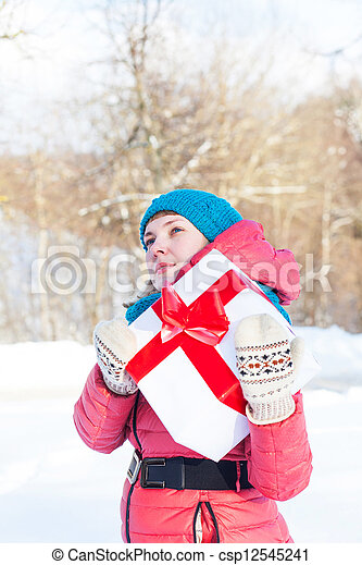 Woman with a present - csp12545241