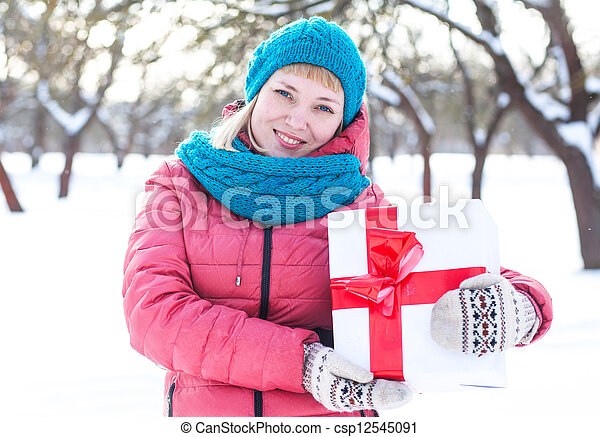 Woman with a present - csp12545091
