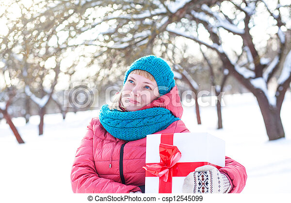 Woman with a present - csp12545099