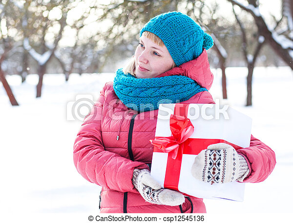 Woman with a present - csp12545136