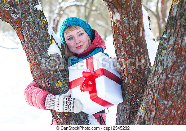 Woman with a present - csp12545232