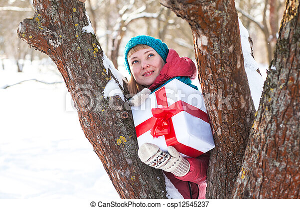 Woman with a present - csp12545237