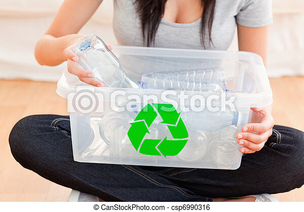 Woman with a recycling box - csp6990316
