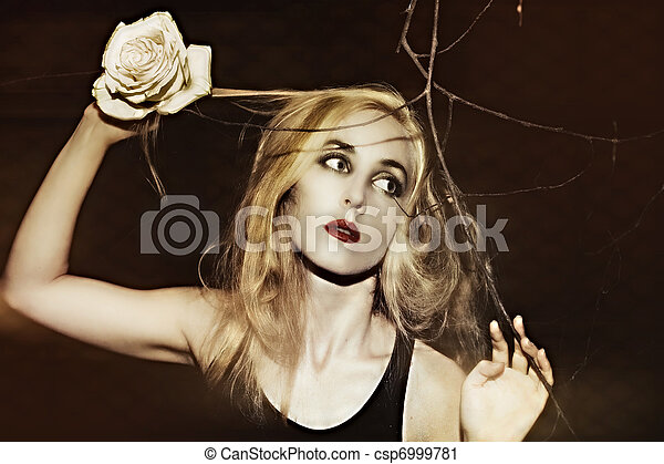 woman with a rose in his hand - csp6999781