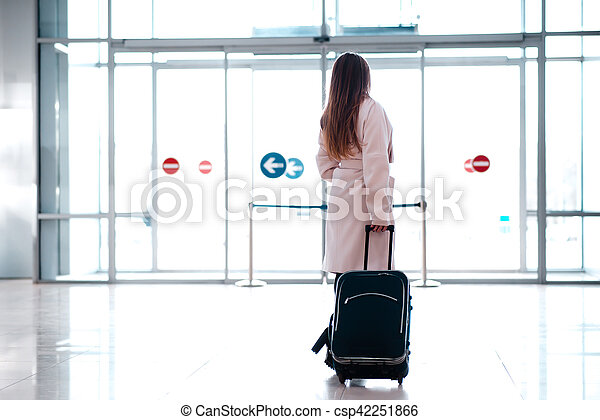Woman with a suitcase goes to exit the station. - csp42251866